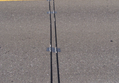 What are the black strips laid across a road measuring?