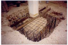 How do we strengthen an existing foundation of an old building?